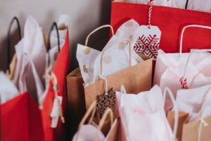 Christmas gifts in red white brown bags for blog on mental load a t Christmas