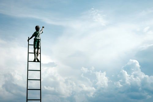 photo of child up ladder reaching for the sky for Continuing Personal Development Plan