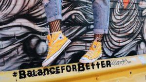 International Women's Day blog #BalanceforBetter woman's feet balancing on a barrier