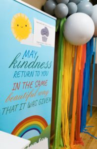 sign reading kindness with rainbow to illustrate blog on the importance of kindness